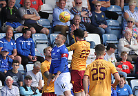 Stephen Dobbie  goes up for the ball with Liam Donnelly in the SPFL Betfred League Cup group match between Queen of the South and Motherwell at Palmerston Park, Dumfries on 13.7.19.