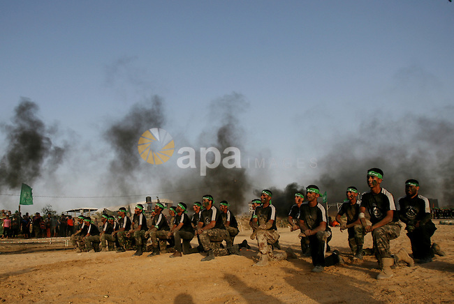 Palestinian youths demonstrate their skills during a graduation ceremony of a military-style summer camp organized by the Hamas movement in Rafah in the southern Gaza Strip June 19, 2014. Hamas stages dozens of military-style summer camps for young Palestinians in the Gaza strip to prepare them to confront any possible Israeli attack, organisers said. Photo by Eyad Al-Baba