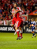 Chicago Fire midfielder John Thorrington (11) celebrates with midfielder Stephen King (33) after King scored the game's only goal.  The Chicago Fire defeated the New York Red Bulls 1-0 at Toyota Park in Bridgeview, IL on September 6, 2008.