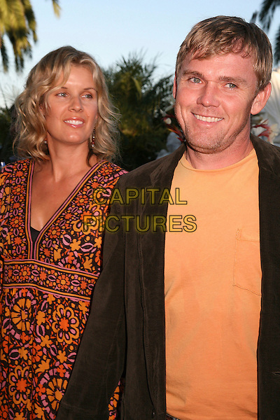 """RICK SCHRODER & GUEST.Bow Wow Ciao Benefit For """"Much Love"""" Animal Rescue, Malibu, California, USA..August 5th, 2006.Photo: Byron Purvis/AdMedia/Capital Pictures.Ref: ADM/BP.half length orange floral print.www.capitalpictures.com.sales@capitalpictures.com.©Byron Purvis/AdMedia/Capital Pictures."""