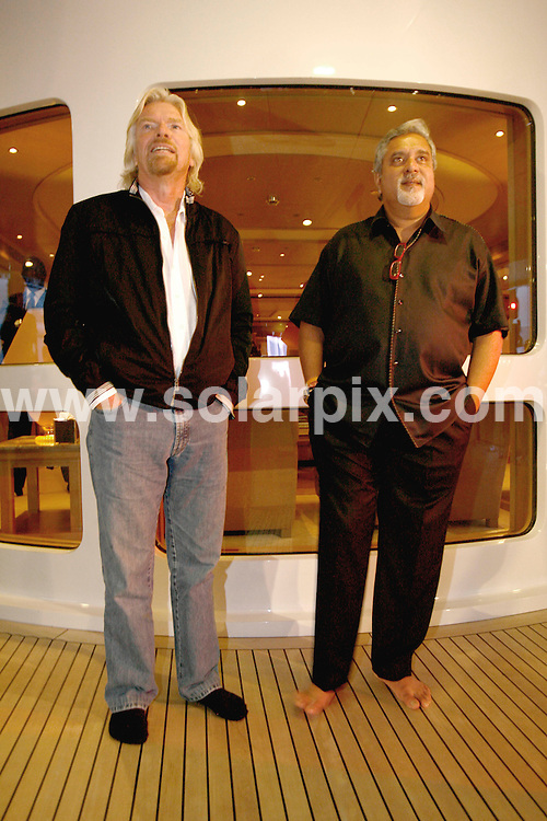 **ALL ROUND PICTURES FROM SOLARPIX.COM**.**SYNDICATION RIGHTS FOR UK AND SPAIN ONLY**.pictured at the Fly Kingfisher party on the Indian Empress in the Harbour of Monaco. during the 62nd Annual Cannes Film Festival. Monaco. 21 May 2009..This pic: Richard Branson and Deejay Emelia..JOB REF: 9073 CPR (Batmitsch) DATE: 21_05_2009.**MUST CREDIT SOLARPIX.COM OR DOUBLE FEE WILL BE CHARGED**.**ONLINE USAGE FEE GBP 50.00 PER PICTURE - NOTIFICATION OF USAGE TO PHOTO @ SOLARPIX.COM**.**CALL SOLARPIX : +34 952 811 768 or LOW RATE FROM UK 0844 617 7637**