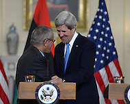 March 13, 2013  (Washington, DC)  Secretary of State John Kerry (r) and Libyan Prime Minister Ali Zeidan (l) shake hands before a bilateral meeting at the Department of State in Washington, D.C.  (Photo by Don Baxter/Media Images International)