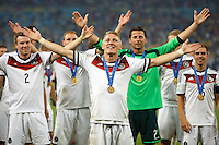 Bastian Schweinsteiger and his Germany team mates clap towards fans