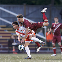 Head ball action. Syracuse University forward Grant Chong (27) and Boston College midfielder Giuliano Frano (15).Boston College (maroon) defeated Syracuse University (white/orange), 3-2, at Newton Campus Field, on October 8, 2013.