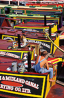 England. Birmingham.  Colourful canal barges tied up in renovated city centre/center canals at Gas Street basin..