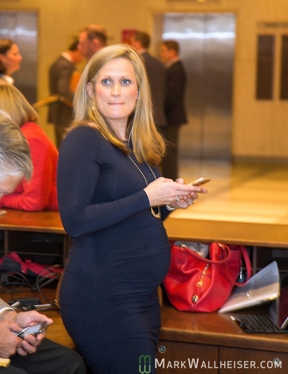 Ashley Mayer Kalifen,  a lobbyist with Capitol City Consulting, waits on the fourth floor rotunda during Florida House of Representatives and Senate floor debates at the Florida Capitol in Tallahassee, Florida.