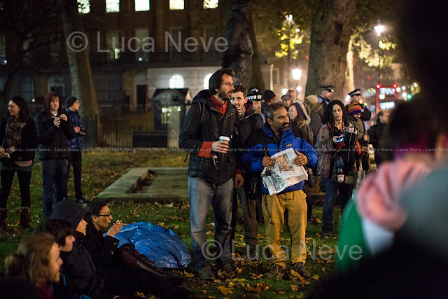 (On the L) George Barda (Peace campaigner and Political activist).<br /> <br /> Day I - 21.11.2014 - &quot;Learn, Discuss, Participate&quot;.<br /> <br /> London 21-23/11/2014. First day of &quot;Return to Parliament Square&quot; at the Occupy Democracy Camp in London. This evening, protesters gathered in Parliament Square to have a 3-day-long re-occupation of the iconic London's landmark to &quot;Learn, Discuss, Participate&quot;. However, the famous grass outside the Houses of Parliament was patrolled by heavy police presence, supported by their dog's unit, deployed in the square and around the fences previously erected to surround and protect the square. After an attempt to occupy the &quot;patch of grass outside 10 Downing Street&quot;, the peaceful protest ended outside the Supreme Court of the United Kingdom where activists set up their new occupation camp. <br /> <br /> For more information please click here: http://occupydemocracy.org.uk/ &amp; http://on.fb.me/12tuv79<br />   <br /> For more photos and information about the previous Occupation please click here: http://bit.ly/1yOPtIc