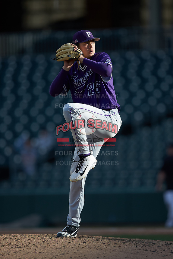 Furman Paladins relief pitcher Eric Taylor (26) in action against the Wake Forest Demon Deacons at BB&T BallPark on March 2, 2019 in Charlotte, North Carolina. The Demon Deacons defeated the Paladins 13-7. (Brian Westerholt/Four Seam Images)