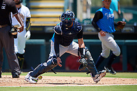 Tampa Tarpons catcher Jason Lopez (10) fields a throw during a Florida State League game against the Bradenton Marauders on May 26, 2019 at LECOM Park in Bradenton, Florida.  Bradenton defeated Tampa 3-1.  (Mike Janes/Four Seam Images)