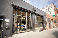 The exterior of the Kings County Brewers Collective in the Bushwick neighborhood of Brooklyn in New York on Sunday, October 16, 2016. The newly opened brewery and taproom is the first brewery to open in Bushwick since 1976 (© Richard B. Levine)