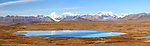 Composite panorama of tundra lake, Maclaren Glacier, and Alaska Range in Southcentral Alaska. Autumn. Afternoon.