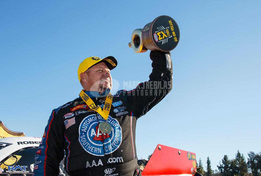 Feb 11, 2019; Pomona, CA, USA; NHRA funny car driver Robert Hight celebrates after winning the Winternationals at Auto Club Raceway at Pomona. Mandatory Credit: Mark J. Rebilas-USA TODAY Sports