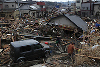 Kesennuma City, Miyagi Prefecture, North East Japan. Kesennuma City is one of the worst affected areas by the massive earthquake and tsunami that hit Northern East part of Japan on 11th March 2011. Every town by the shores has been swept away by 10-15 meter high tsunami after the M10 earthquake. People who escaped and climbed up on the hill survived but many still remain missing. Part of the town is still in water. There have been fires. Military (Jieitai) and rescue teams as well as the locals search family members that are still missing, look for their houses and take belongings. .15 Mar 2011