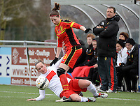 20140208 - OOSTAKKER , BELGIUM : Belgian Heleen Jaques (r) pictured in a duel with Polish Natalia Chudzik (l) during a friendly soccer match between the women teams of Belgium and Poland , Saturday 8 February 2014 in Oostakker. PHOTO DAVID CATRY