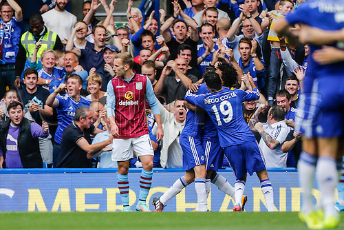 27.09.2014.  London, England. Barclays Premier League. Chelsea versus Aston Villa from Stamford Bridge.  Oscar of Chelsea is congratulated by team mates after scoring the first goal of the game.