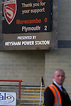 The stadium scoreboard displays the final score as Morecambe hosted Plymouth Argyle in a League 2 fixture at the Globe Arena. The stadium was opened in 2010 and replaced Morecambe's traditional home of Christie Park which had been their home since 1921, the year after their foundation. Plymouth won this fixture by 2-0 watched by 2,081 spectators, in a game delayed by 30 minutes due to traffic congestion affecting travelling Argyle fans.
