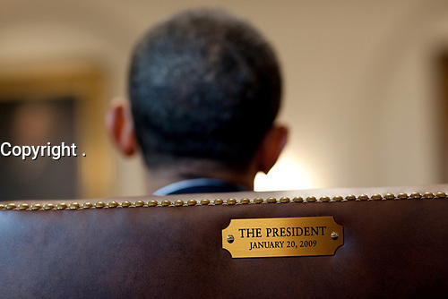 President Barack Obama meets with members of his Cabinet in the Cabinet Room of the White House, Jan. 29, 2010. The President's chair is marked with a plaque engraved with the date of his inauguration. (Official White House Photo by Pete Souza)<br /> <br /> This official White House photograph is being made available only for publication by news organizations and/or for personal use printing by the subject(s) of the photograph. The photograph may not be manipulated in any way and may not be used in commercial or political materials, advertisements, emails, products, promotions that in any way suggests approval or endorsement of the President, the First Family, or the White House.