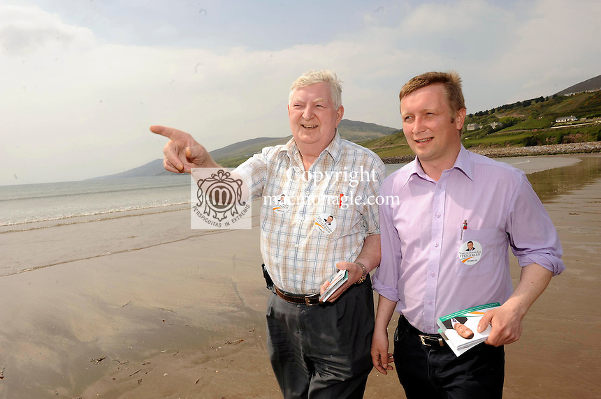 12-5-09 dingle canvas; Life's a beach for Fianna Fail candidate Brendan Fitzgerald as he canvassses with his father Tom on Inch Beach on Tuesday. Picture by by Don MacMonagle