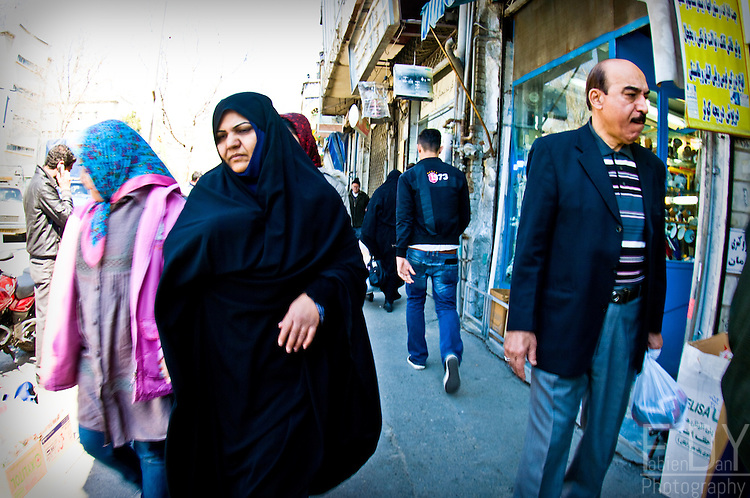 Iranians going shopping before Noruz, the persian new year on the first day of spring. Tehran's bazar, march 2011.