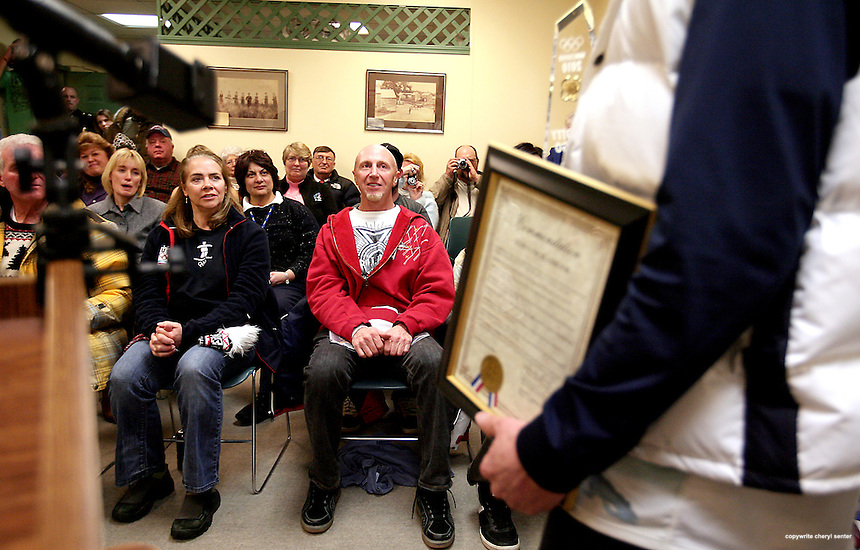 Olympic halfpipe bronze medalist Scotty Lago's parents, facing center, Christine and Michael Lago Jr, listen as he speaks after recieving the key to the town of Seabrook during a ceremony at the town in Seabrook, N.H., Sunday, Feb. 27, 2010. (Portsmouth Herald Photo/Cheryl Senter)