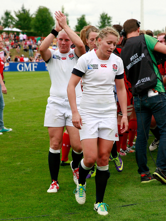 Heather Fisher and Natasha Hunt leave the pitch. England v Canada Pool A match at WRWC 2014 at Centre National de Rugby, Marcoussis, France, on 9th August 2014