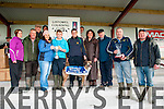 Listowel Coursing: Kian Regan & his father SeanRregan from Banna accepting the throphies as their dog Banna Airport won the Jackie Hegarty Memorial Cup at Listowel on Sunday last.