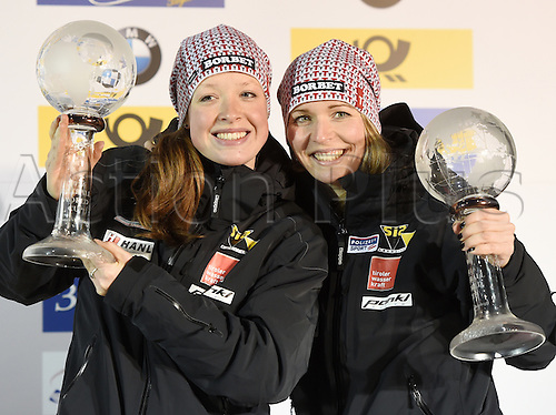 26.02.2016. Koenigssee,  Berchtesgaden, Germany.  Austrian Bobsleigh pilots Christina Hengster (r) and Sanne Monique Dekker holding up their trophies for the third place at the 2-women Bobsleigh World Cup at Koenigssee