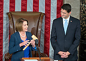 Incoming Speaker of the United States House of Representatives Paul Ryan (Republican of Wisconsin), right, waits to accept the gavel from former Speaker of the US House of Representatives and current US House Minority Leader Nancy Pelosi (Democrat of California), left, in the US House Chamber in the US Capitol in Washington, DC on Thursday, October 29, 2015.<br /> Credit: Ron Sachs / CNP