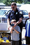Police officer and boy with radar unit .