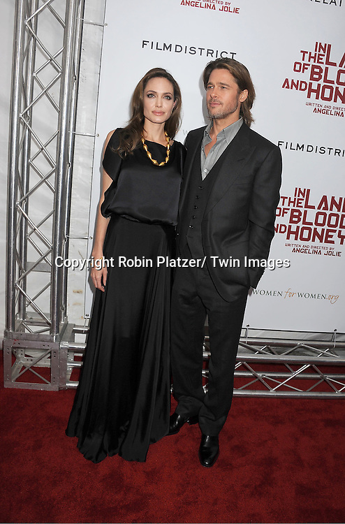 """Angelina Jolie and Brad Pitt attend The New York Premiere of Angelina Jolie's movie .."""" In the Land of Blood and Honey"""" on December 5, 2011 at The School of Visual Arts Theatre in New York City."""