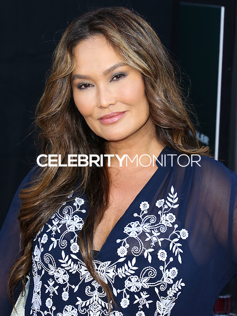 HOLLYWOOD, LOS ANGELES, CA, USA - OCTOBER 06: Tia Carrere arrives at the World Premiere Of Disney's 'Alexander And The Terrible, Horrible, No Good, Very Bad Day' held at the El Capitan Theatre on October 6, 2014 in Hollywood, Los Angeles, California, United States. (Photo by Xavier Collin/Celebrity Monitor)