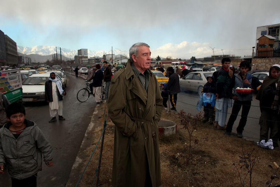 "In the Afghan capital, Kabul, journalist Dan Rather prepares to deliver a ""stand-up"" televised report before cameras from his ""Dan Rather Reports"" television program in late December 2008."