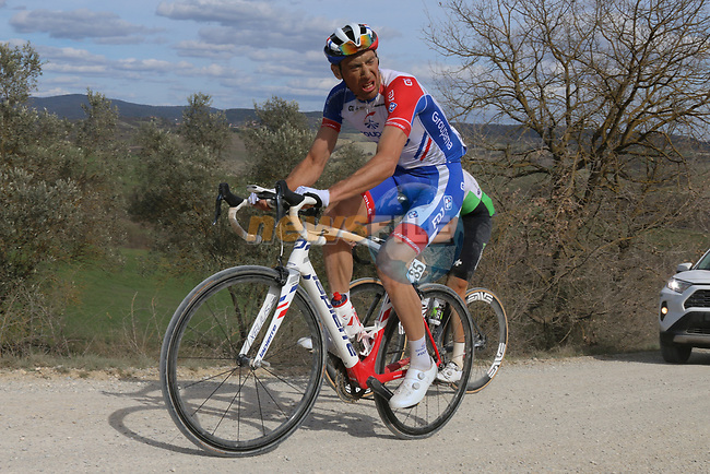 The peloton including Matthieu Ladagnous (FRA) Groupama-FDJ climb sector 8 Monte Santa Maria during Strade Bianche 2019 running 184km from Siena to Siena, held over the white gravel roads of Tuscany, Italy. 9th March 2019.<br /> Picture: Seamus Yore | Cyclefile<br /> <br /> <br /> All photos usage must carry mandatory copyright credit (© Cyclefile | Seamus Yore)