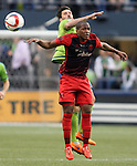 Seattle Sounders Brad Evans (3) heads the ball away from Portland Timbers Darlington Nagbe (6) during an MLS match on April 26, 2015 at CenturyLink Field in Seattle, Washington.  Seattle Sounders Clint Dempsey scored a goal to give the Sounders a 1-0 victory over the Timbers. Jim Bryant Photo. ©2015. All Rights Reserved.