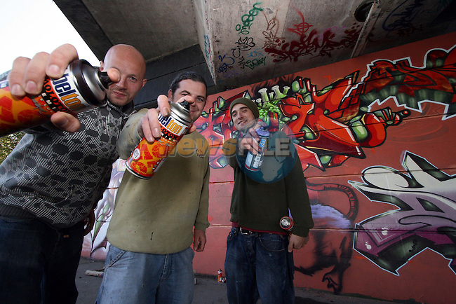 Graffiti artists Lars Pedersen, Darren Finnegan and Barry Finnegan finish the murals under the Bridge of Peace in Drogheda...Photo NEWSFILE/Jenny Matthews.(Photo credit should read Jenny Matthews/NEWSFILE)....This Picture has been sent you under the condtions enclosed by:.Newsfile Ltd..The Studio,.Millmount Abbey,.Drogheda,.Co Meath..Ireland..Tel: +353(0)41-9871240.Fax: +353(0)41-9871260.GSM: +353(0)86-2500958.email: pictures@newsfile.ie.www.newsfile.ie.FTP: 193.120.102.198.