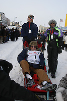 Saturday March 6 , 2010  Honorary musher, Oren Seybert of Penair in the sled  during the ceremonial start of the 2010 Iditarod in Anchorage , Alaska