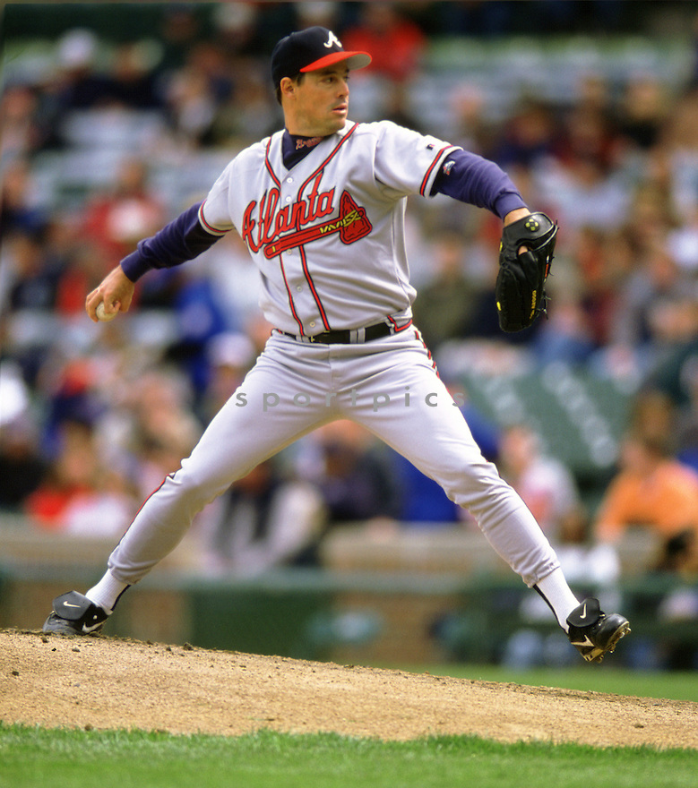 Atlanta Braves Greg Maddux (31) during a game from his 2000 season at Wrigley Field in Chicago Illinois. Greg Maddux played for 23 years with 4 different teams, was a 8-time All-Star, a 4-time Cy Young award winner and was inducted to the Baseball Hall of Fame in 2014.