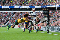 Adam Thomson of Barbarians dives over to score a try as Henry Speight of Australia attempts to stop him in vain during the Killik Cup match between Barbarians and Australia at Twickenham Stadium on Saturday 1st November 2014 (Photo by Rob Munro)