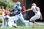 01 September 2012: UNC's Giovani Bernard (26) and Elon's Kenton Beal (84). The University of North Carolina Tar Heels played the Elon University Phoenix at Kenan Memorial Stadium in Chapel Hill, North Carolina in a 2012 NCAA Division I Football game. UNC won the game 62-0.