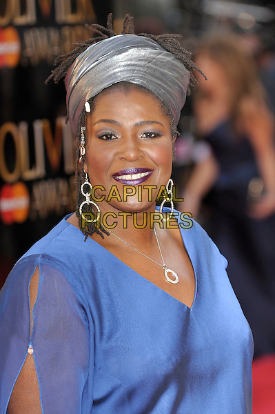 Sharon D. Clarke.The Olivier Awards 2012, Royal Opera House, Covent Garden, London, England..April 15th, 2012.headshot portrait blue grey gray turban hat earrings silver necklace .CAP/PL.©Phil Loftus/Capital Pictures.