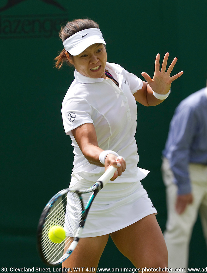 Na Li..Tennis - Grand Slam - The Championships Wimbledon - AELTC - The All England Club - London - Mon June 25th 2012. .© AMN Images, 30, Cleveland Street, London, W1T 4JD.Tel - +44 20 7907 6387.mfrey@advantagemedianet.com.www.amnimages.photoshelter.com.www.advantagemedianet.com.www.tennishead.net