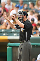 Umpire Travis Eggert handles the calls on behind the plate during the Pacific Coast League game between the Salt Lake Bees and the Reno Aces at Smith's Ballpark on July 24, 2014 in Salt Lake City, Utah.  (Stephen Smith/Four Seam Images)
