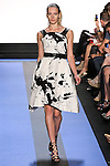Teva walks runway in a chalk white splatter print faille hi-low cocktail dress with crackle leather straps, by Monique Lhuillier, from the Monique Lhuillier Spring 2012 collection fashion show, during Mercedes-Benz Fashion Week Spring 2012.