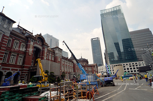 May 29, 2012, Tokyo, Japan - JP Tower, a 200-meter-tall office building of Japan Post Group, rises above the historic facade of the former Tokyo Central Post Office in the Marunouchi business district of Tokyo on Tuesday, May 29, 2012. ..With the completion of the tower at the end of May and the October grand opening of the restored Tokyo Central, left, there will be a significant change in the vista in front of the Imperial Palace. (Photo by Natsuki Sakai/AFLO)