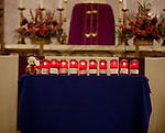 WATERBURY, CT-19 December 2012-121912BF02-- The name of the Newtown victims are displayed on devotional candles on the alter inside the Basilica of the Immaculate Conception Wednesday night in Waterbury.  The mass was held to honor teachers in the aftermath of the Sandy Hook Elementary School shootings in Newtown last Friday. Bob Falcetti Republican-American