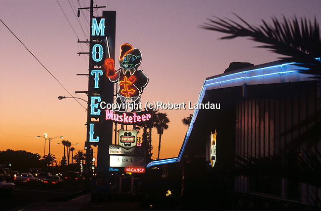 Musketeer Motel neon sign lit up at dusk near Disneyland in Anaheim, CA