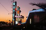 Musketeer Motel neon sign lit up at dusk near Disneyland in Anaheim, CA