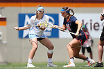 01 May 2016: North Carolina's Molly Hendrick (left) and Syracuse's Kayla Treanor (21) challenge for a draw. The University of North Carolina Tar Heels played the Syracuse University Orange at Lane Stadium in Blacksburg, Virginia in the 2016 Atlantic Coast Conference Women's Lacrosse Tournament championship match. North Carolina won 15-14 in overtime.
