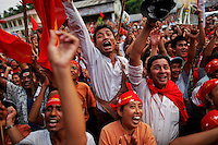 Supporters celebrate as some results are shown on the screen in front of Aung San Suu Kyi's National League for Democracy head office in Yangon April 1, 2012. REUTERS/Damir Sagolj (MYANMAR - Tags: ELECTIONS POLITICS)
