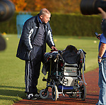 Ally McCoist takes time out to chat to a wheelchair bound young fan during training